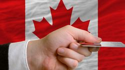 Canadians Piling On Debt At Fastest Rate In