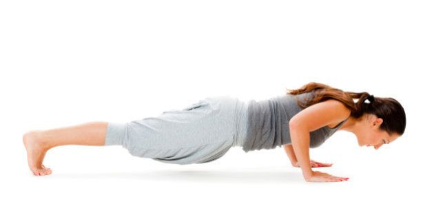 young woman doing push up...