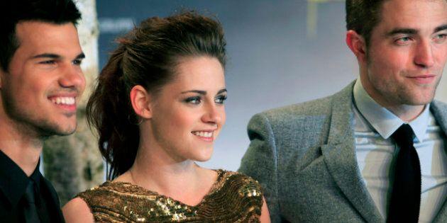 (L-R) US actor Taylor Lautner, US actress Kristen Stewart and British actor Robert Pattinson pose prior...