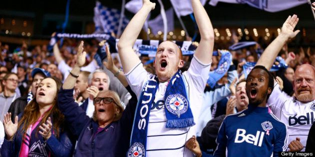 VANCOUVER, CANADA - OCTOBER 3: Fans of the Vancouver Whitecaps FC celebrate another goal against Chivas...