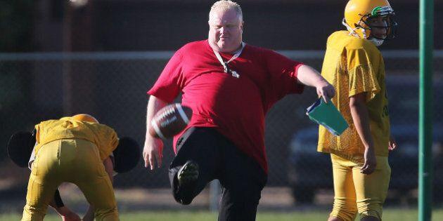 TORONTO, ON - SEPTEMBER 12: Toronto Mayor Rob Ford punts as he runs football practice at Don Bosco Secondary...