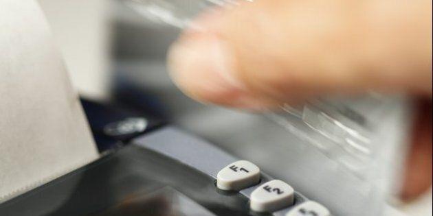 Close up of hand swiping credit
