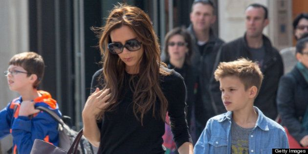 PARIS, FRANCE - APRIL 21: Victoria Beckham and her son Romeo James are seen leaving the 'NIKE' store...