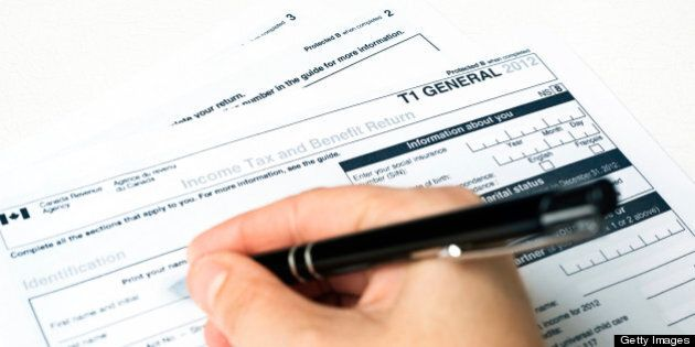 Filling out a 2012 Revenue Canada General T1 Tax Form.