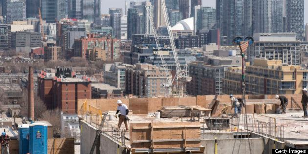 TORONTO, ON - APRIL 26: Construction workers are seen working on a condo building on Sudbury Street near...