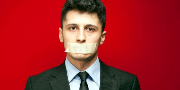 Businessman Taped Mouth