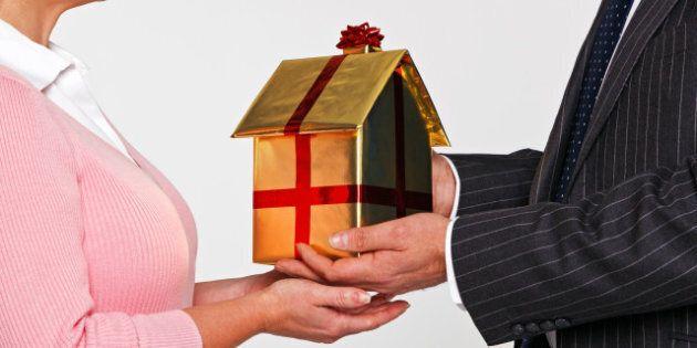 a businessman giving a woman