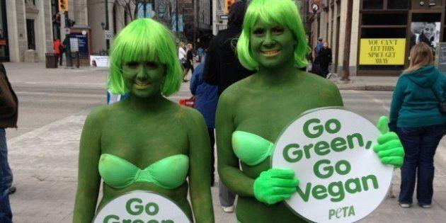 PETA Protest Calgary: Activists In Green Bikinis, Bodypaint On Stephen Avenue Ask Calgarians To Go Vegan