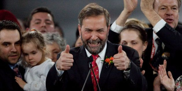 Thomas Mulcair celebrates his win at the NDP leadership convention in Toronto, Ontario, March 24, 2012....