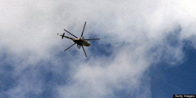 A Syrian army helicopter flies over the northern city of Aleppo on October 9, 2012. Syrian rebels overrun...