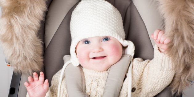 funny little baby in a warm hat