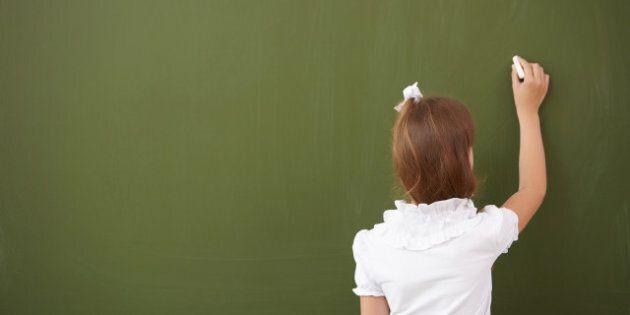 scoolgirl standing in class...