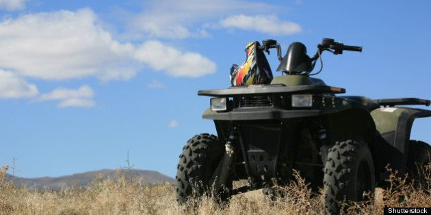 atv parked on hill with