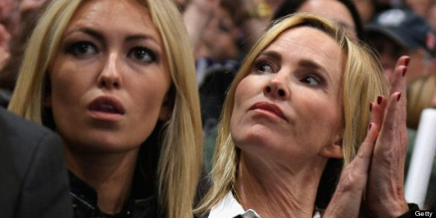 LOS ANGELES, CA - JUNE 04: The wife of Wayne Gretzky, Janet Jones sits with daughter Paulina for Game...