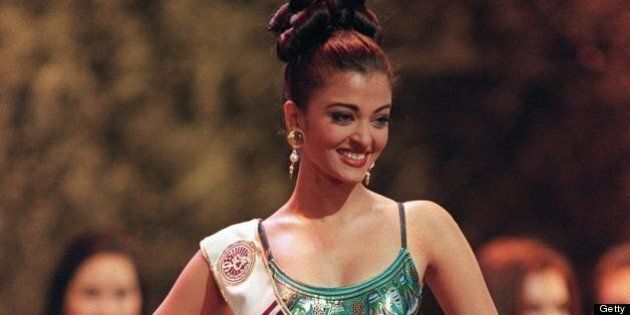SUN CITY, SOUTH AFRICA - NOVEMBER 20:  Aishwarya Rai of India competes in the swimsuit parade during the finals for Miss World 1994 in Sun City, 20 November 1994.  (Photo credit should read WALTER DHLADHLA/AFP/Getty Images)