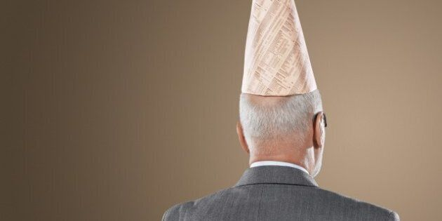 businessman wearing dunce hat