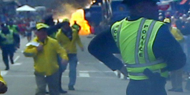 BOSTON - APRIL 15: A second explosion goes off (rear) as a runner was blown to the ground by the first...
