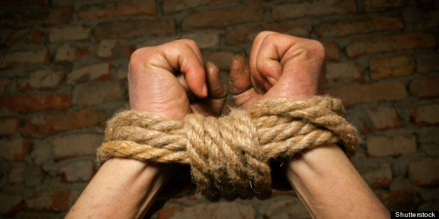hands of man tied up with