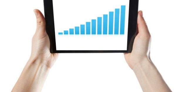 Holding Digital Tablet with statistics isolated on white