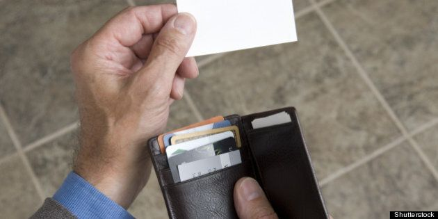 man holding his wallet