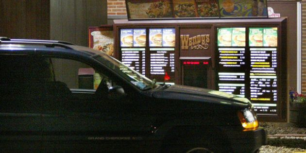 CHICAGO - JULY 15: A driver places a drive-up order at a Wendy's fast-food restaurant July 15, 2004 in...