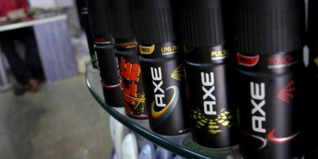 INDIA - OCTOBER 03: Cans of Axe body spray, made by Hindustan Unilever Ltd., sit for sale on a store...