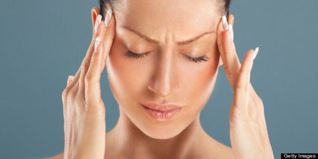 Woman got a headache attack.Head