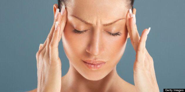 Woman got a headache attack.Head massage.
