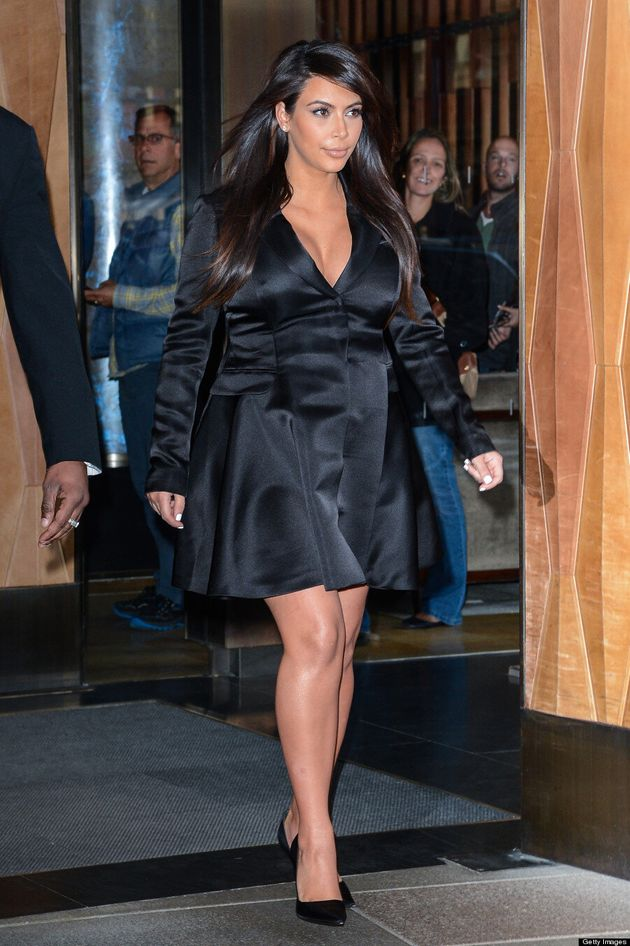 Kim Kardashian Hides Baby Bump, Shows Off Cleavage In Tuxedo Dress (VIDEO,