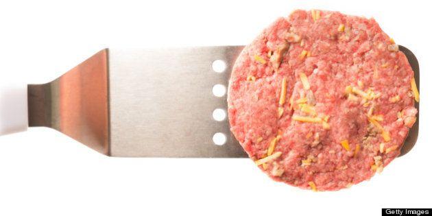 Raw Hamburger Patty Isolated on White