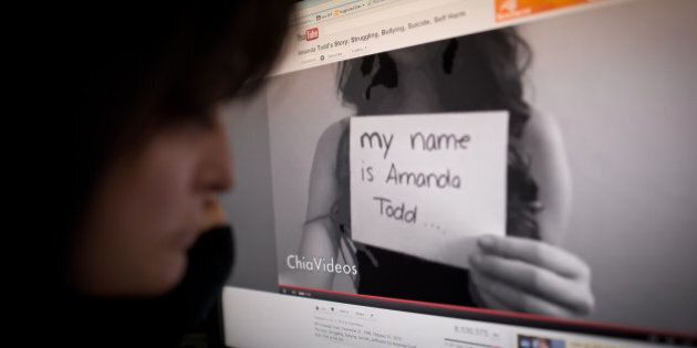 A woman views the YouTube video of Amanda Todd on an office monitor in Washington, DC on October 16,...