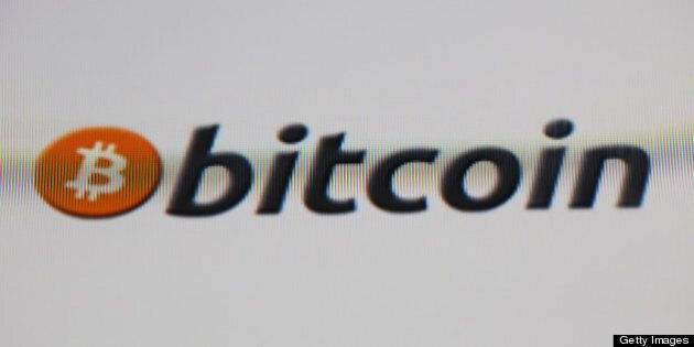 A computer screen displays the Bitcoin logo on an internet website in London, U.K., on Wednesday, April...