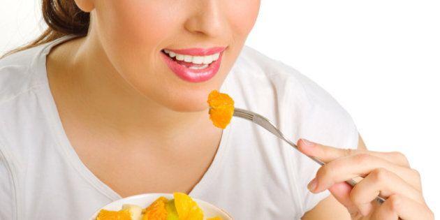 girl eat fruit