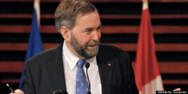 Description fr:Thomas Mulcair | Thomas Mulcair , député néo-démocrate de la circonscription d'Outremont...