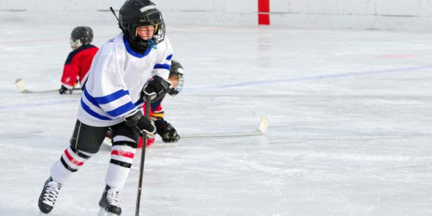 a young hockey player races...