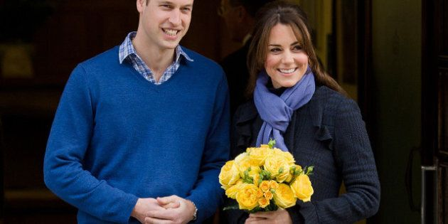 Britain's Prince WiIliam, the Duke of Cambridge, (L) poses for pictures with his wife Catherine, Duchess...
