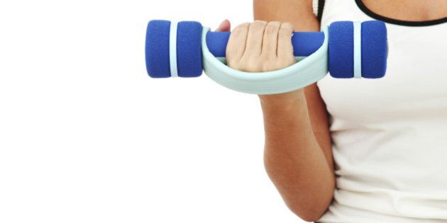dumbbells in woman hands...
