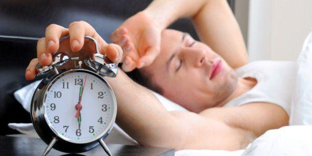 man sleeping with alarm