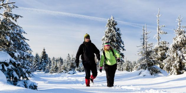 man and woman hikers walking in