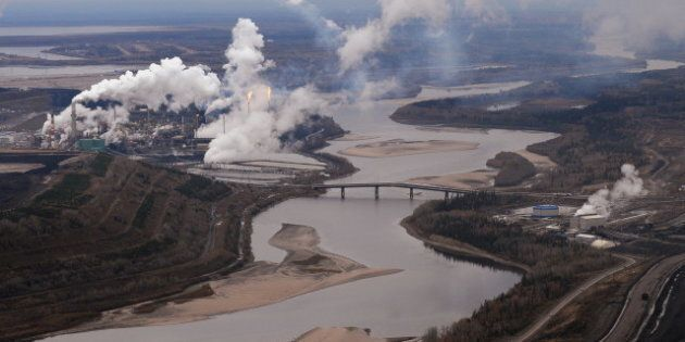 Aerial view of the Suncor oil sands extraction facility on the banks of the Athabasca River and near...