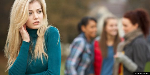 upset teenage girl with friends