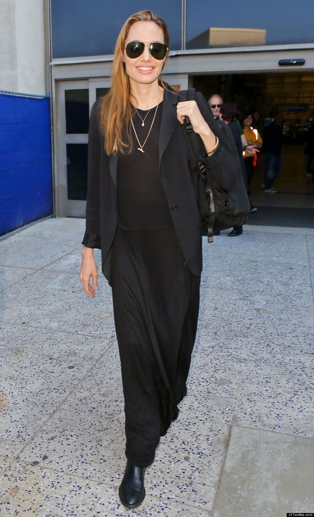 Angelina Jolie Covers Up In Black; Switches Engagement Ring