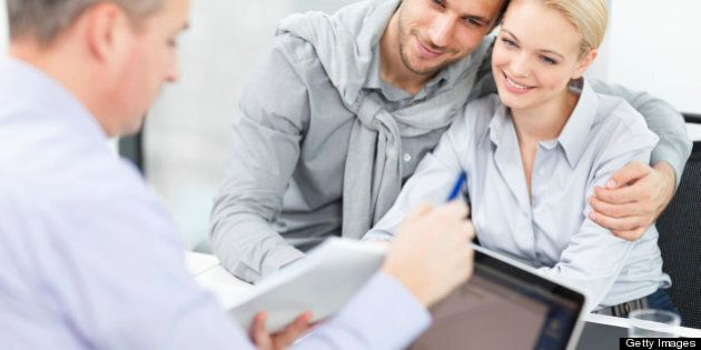 Young couple at meeting with financial