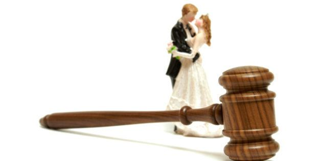 a gavel with a bride and groom...