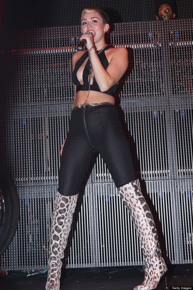 Miley Cyrus Boobs: Singer Shows Cleavage In Leather Bondage Outfit