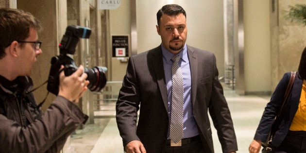 TORONTO, ON - JUNE 5: Const. Babak Andalib-Goortani leaves College Park court on the day his trial is...