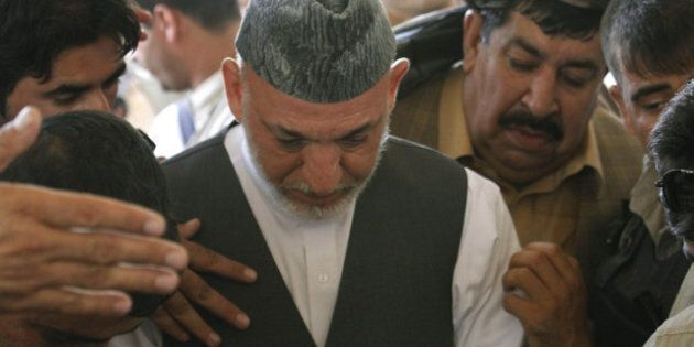 Hamid Karzai Weeps Over Slain Brother At Funeral, Pleads For Peace In
