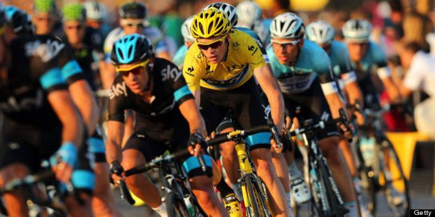 PARIS, FRANCE - JULY 21: Chris Froome of Great Britain and SKY Procycling (C) rides in the wheel of teammate...