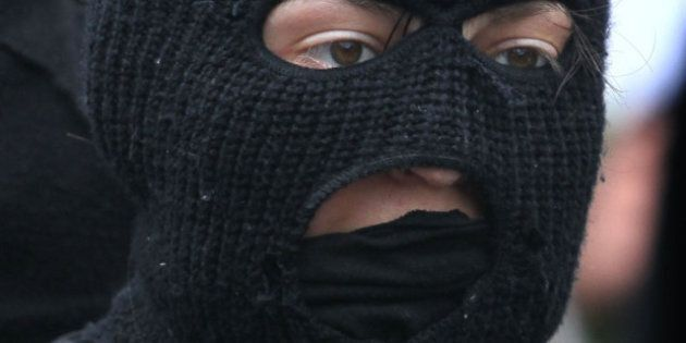Mask Ban Bill Back Up For Debate By