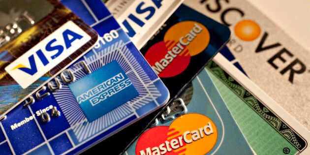 American Express, Discover, MasterCard and Visa credit cards are displayed for a photograph in New York,...